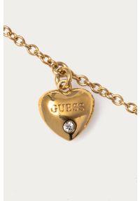 Złota bransoletka Guess metalowa