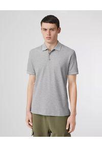Burberry - BURBERRY - Szara koszulka z logo. Okazja: na co dzień. Typ kołnierza: polo. Kolor: szary. Materiał: bawełna, dresówka, elastan, wełna. Wzór: haft, aplikacja. Sezon: lato. Styl: klasyczny, casual