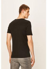 Czarny t-shirt Puma casualowy, na co dzień, z okrągłym kołnierzem, z nadrukiem