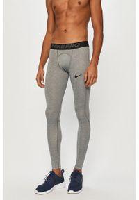 Nike - Legginsy. Kolor: szary. Materiał: dzianina, tkanina, włókno, skóra