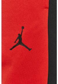 Czerwone spodnie dresowe Jordan z aplikacjami