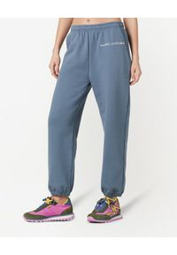 THE MARC JACOBS - Niebieskie spodnie dresowe z logo. Kolor: niebieski. Materiał: dresówka. Wzór: aplikacja