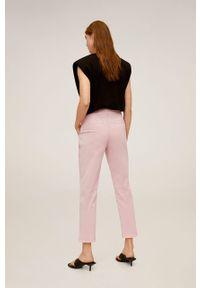 Różowe spodnie materiałowe mango na co dzień, casualowe