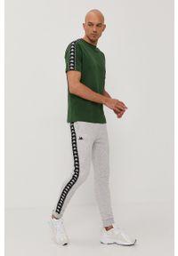Kappa - Spodnie. Kolor: szary. Wzór: nadruk