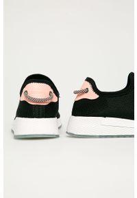 Czarne buty sportowe Tommy Jeans z cholewką, na średnim obcasie
