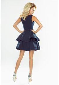 Numoco - Mocno rozkloszowana sukienka z dwiema falbanami. Okazja: na wesele, na ślub cywilny, na komunię. Materiał: wiskoza, poliester, materiał #3
