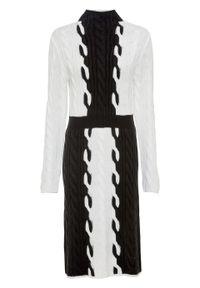 Sukienka dzianinowa bonprix czarno-biały. Typ kołnierza: kołnierzyk stójkowy. Kolor: czarny. Materiał: dzianina, materiał, akryl. Długość rękawa: długi rękaw. Typ sukienki: dopasowane