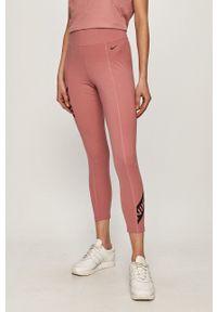 Nike - Legginsy. Kolor: różowy. Materiał: tkanina, dzianina, skóra, włókno. Technologia: Dri-Fit (Nike). Wzór: nadruk
