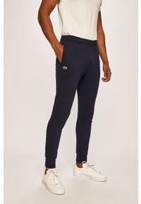 Lacoste - Spodnie XH9507. Kolor: niebieski. Materiał: materiał, bawełna, dzianina, poliester, elastan. Wzór: gładki #1