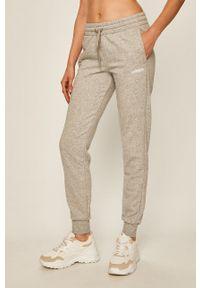 Szare spodnie dresowe Adidas melanż