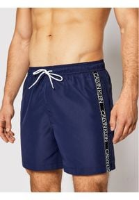 Calvin Klein Swimwear Szorty kąpielowe Medium Drawstring KM0KM00558 Granatowy Regular Fit. Kolor: niebieski