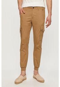 PRODUKT by Jack & Jones - Produkt by Jack & Jones - Spodnie. Okazja: na co dzień. Kolor: brązowy. Materiał: tkanina. Wzór: gładki. Styl: casual