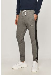 Szare spodnie dresowe Champion z aplikacjami