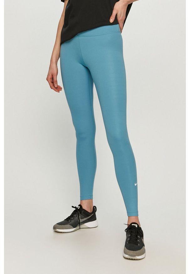Nike - Legginsy. Stan: podwyższony. Kolor: niebieski. Materiał: tkanina, dzianina, poliester, elastan, włókno, skóra. Wzór: gładki