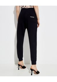 NANUSHKA - Czarne spodnie dresowy Shay. Kolor: czarny. Materiał: dresówka