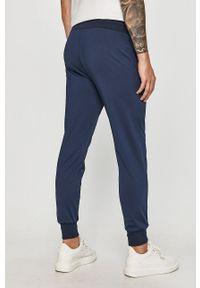 Niebieskie spodnie dresowe Guess Jeans z nadrukiem