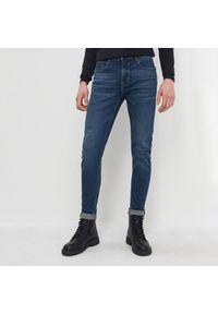 House - Jeansy slim fit z bawełny organicznej - Granatowy. Kolor: niebieski