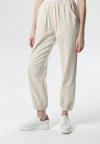Beżowe spodnie materiałowe Born2be