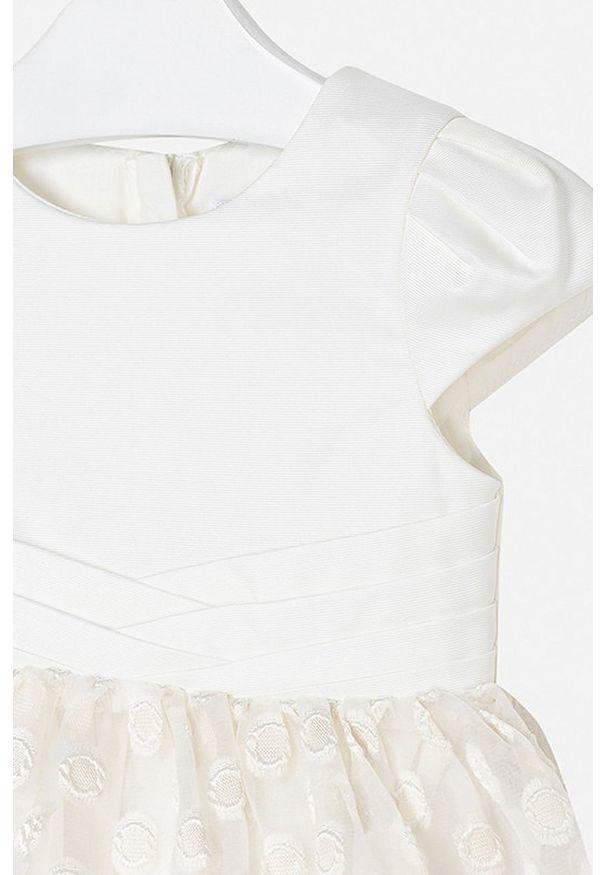 Kremowa sukienka Mayoral z krótkim rękawem, rozkloszowana