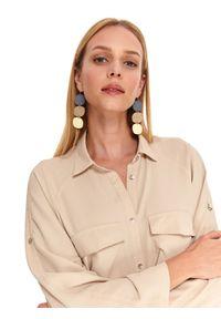 TOP SECRET - Luźna koszula z rozszerzanymi rękawami. Okazja: do pracy, na co dzień. Kolor: beżowy. Długość: długie. Wzór: aplikacja. Sezon: jesień. Styl: casual