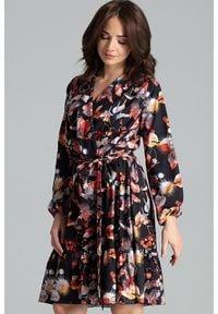 Lenitif - Rozkloszowana kopertowa sukienka midi z falbaną BOHO liście. Okazja: na randkę, na imprezę. Typ kołnierza: kokarda. Długość rękawa: długi rękaw. Typ sukienki: kopertowe. Styl: boho. Długość: midi