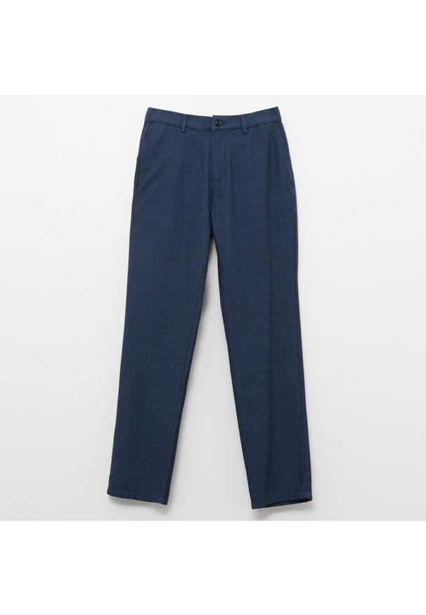 Niebieskie spodnie Reserved