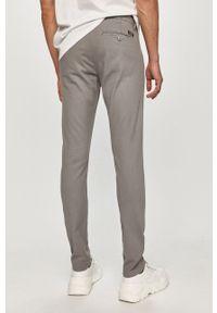 Guess - Spodnie. Kolor: szary. Materiał: tkanina