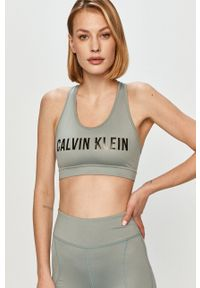 Calvin Klein Performance - Biustonosz sportowy. Kolor: zielony. Rodzaj stanika: odpinane ramiączka. Wzór: nadruk