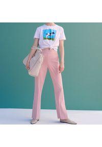 Reserved - Spodnie z rozszerzaną nogawką - Różowy. Kolor: różowy