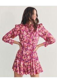 LOVE SHACK FANCY - Wzorzysta mini sukienka Mayberry. Kolor: wielokolorowy, różowy, fioletowy. Materiał: poliester, materiał. Wzór: kwiaty. Typ sukienki: rozkloszowane. Długość: mini