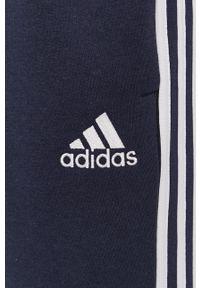 Adidas - adidas - Spodnie. Okazja: na co dzień. Kolor: niebieski. Materiał: dzianina, poliester. Styl: casual