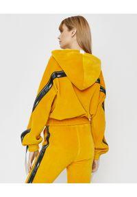 JOANNA MUZYK - Bluza z kapturem. Typ kołnierza: kaptur. Kolor: żółty. Materiał: dresówka, materiał, bawełna. Długość rękawa: długi rękaw. Długość: długie. Wzór: aplikacja