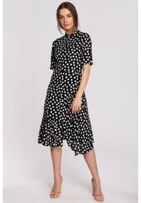 e-margeritka - Sukienka wiskozowa midi z falbaną - xl, czarny. Typ kołnierza: kołnierzyk stójkowy. Kolor: żółty, czarny. Materiał: wiskoza. Typ sukienki: rozkloszowane, asymetryczne. Długość: midi