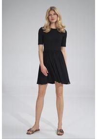 e-margeritka - Sukienka wiskozowa na lato rozkloszowana czarna - l. Kolor: czarny. Materiał: wiskoza. Sezon: lato. Typ sukienki: rozkloszowane