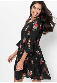 Sukienka z falbanami bonprix czarny w kwiaty. Kolor: czarny. Wzór: kwiaty. Długość: mini