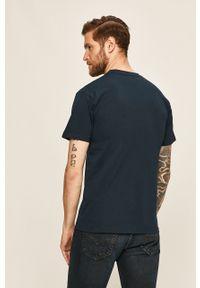 Niebieski t-shirt Vans casualowy, na co dzień, z okrągłym kołnierzem, z nadrukiem