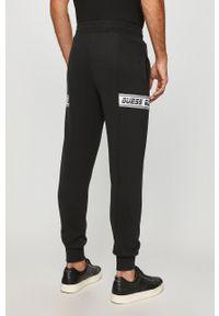 Czarne spodnie dresowe Guess Jeans z aplikacjami #4