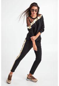 Liu Jo Sport - BLUZA LIU JO SPORT. Długość rękawa: długi rękaw. Długość: długie. Wzór: ażurowy, aplikacja. Styl: sportowy