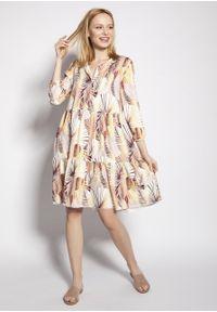 e-margeritka - Sukienka trapezowa koszulowa z falbanami za kolano - 38/40. Kolekcja: moda ciążowa. Materiał: tkanina, wiskoza, materiał. Sezon: lato. Typ sukienki: koszulowe, trapezowe