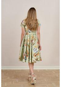 Marie Zélie - Sukienka Alana Geodetia miętowa. Typ kołnierza: kokarda. Kolor: miętowy. Materiał: bawełna, skóra, materiał, elastan. Długość rękawa: krótki rękaw. Styl: wizytowy, elegancki