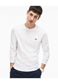 Lacoste - LACOSTE - Biała koszulka z długim rękawem. Okazja: do pracy, na spotkanie biznesowe, na co dzień. Kolor: biały. Materiał: dzianina, jeans. Długość rękawa: długi rękaw. Długość: długie. Wzór: haft. Styl: biznesowy, klasyczny, casual