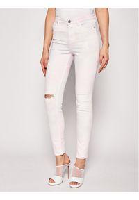 Różowe jeansy slim Guess
