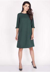 Nommo - Zielona Sukienka Trapezowa Mini z Uroczymi Kokardkami. Typ kołnierza: kokarda. Kolor: zielony. Materiał: wiskoza, poliester. Typ sukienki: trapezowe. Długość: mini