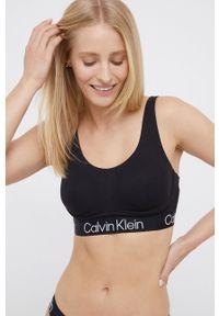 Calvin Klein Underwear - Biustonosz sportowy. Kolor: czarny. Rodzaj stanika: odpinane ramiączka