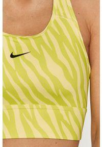 Nike - Biustonosz sportowy. Kolor: zielony. Materiał: włókno, skóra, tkanina. Rodzaj stanika: odpinane ramiączka. Technologia: Dri-Fit (Nike)
