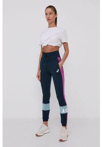 Asics - Spodnie. Kolor: niebieski