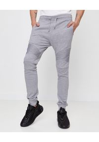 Balmain - BALMAIN - Szare spodnie dresowe. Kolor: szary. Materiał: dresówka