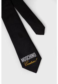 MOSCHINO - Moschino - Krawat. Kolor: czarny. Materiał: materiał. Wzór: gładki