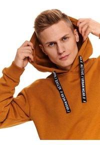 TOP SECRET - Camelowa bluza typu kangurka. Okazja: na co dzień. Kolor: brązowy. Materiał: materiał. Długość rękawa: długi rękaw. Długość: długie. Sezon: zima. Styl: casual