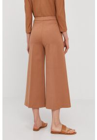 Liviana Conti - Spodnie. Kolor: brązowy. Materiał: dzianina